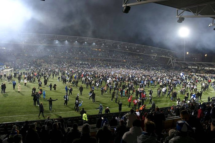 fans-storming-the-field-after-their-team-qualified-for-european-championship
