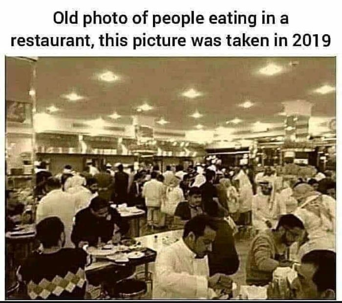 old-photo-of-people-eating-in-a-busy-restaurant-year-2019