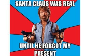 """A meme of Chuck Norris of him holding guns with """"Santa Claus was real...until he forgot my present"""" written on it"""