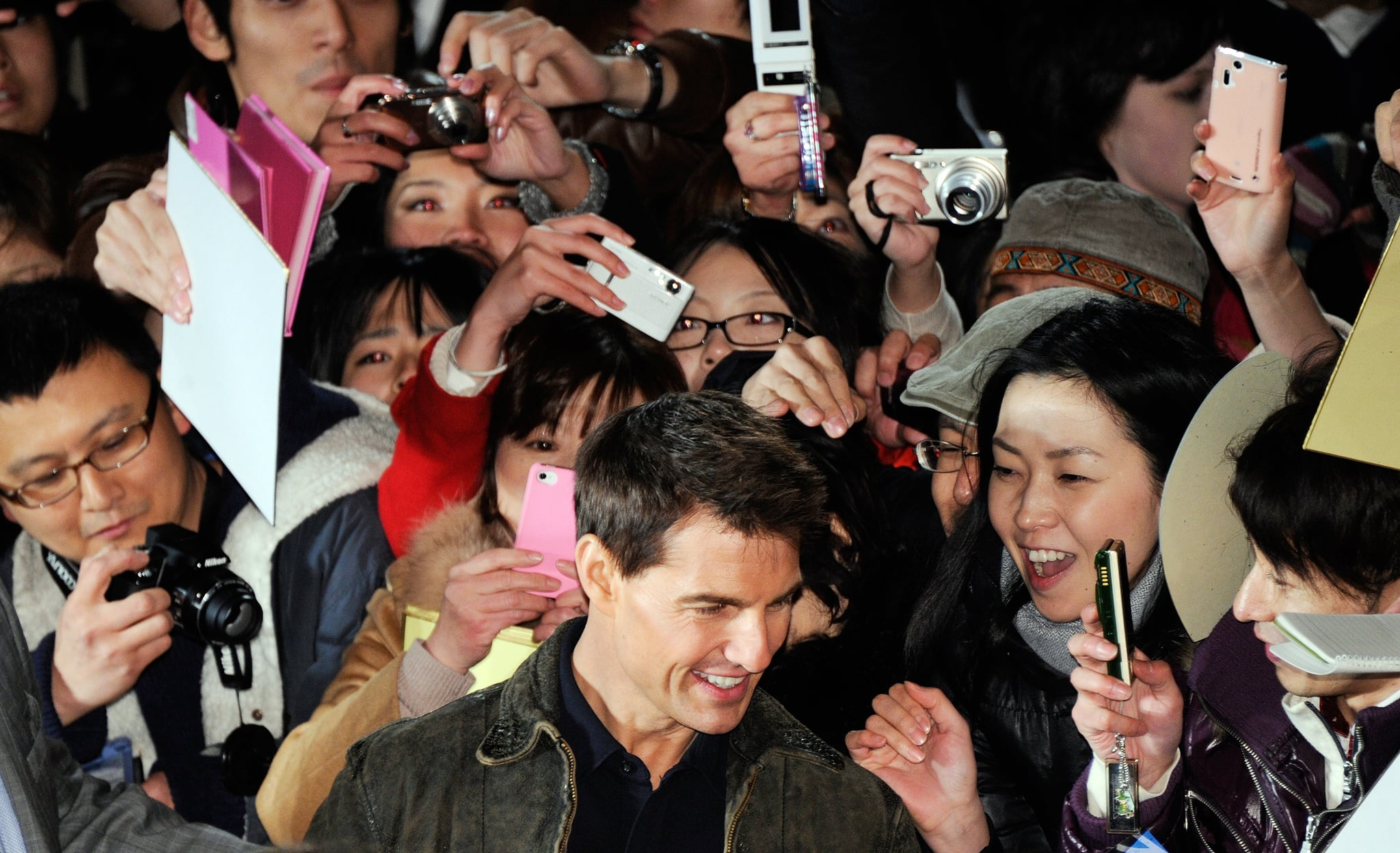 Tom Cruise took photos with fans in Japan. | Tom Cruise Greets Tokyo Amid  Rumors It May Not Be His Final Mission | POPSUGAR Celebrity Photo 9