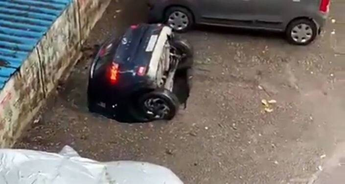 in-india-after-heavy-rains-right-in-the-parking-lot-the-car-was-sucked-into-the-ground